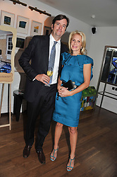 KARL & HOLLY PETERSON at a dinner hosted by Marlon and Nadya Abela in aid of Kids Company at Morton's, Berkeley Square, London on 25th September 2012.