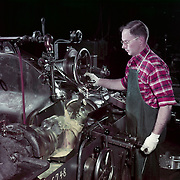 A Studebaker worker operates a crankshaft grinder in the company's Machine Shop in 1952.