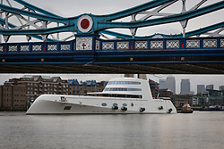 © Licensed to London News Pictures. 10/09/2016. LONDON, UK.  Motor Yacht A leaves London under Tower Bridge on the River Thames early this morning with Canary Wharf in the background. The £225m superyacht, owned by Russian billionaire, Andrey Melnichenko (known as the King of Bling) has spent the last week moored next to HMS Belfast during a London visit. Motor Yacht A is 390ft long, was designed by Philippe Starck, inspired by a submarine and is now reported to be up for sale because Melnichenko is building a new superyacht.  Photo credit: Vickie Flores/LNP