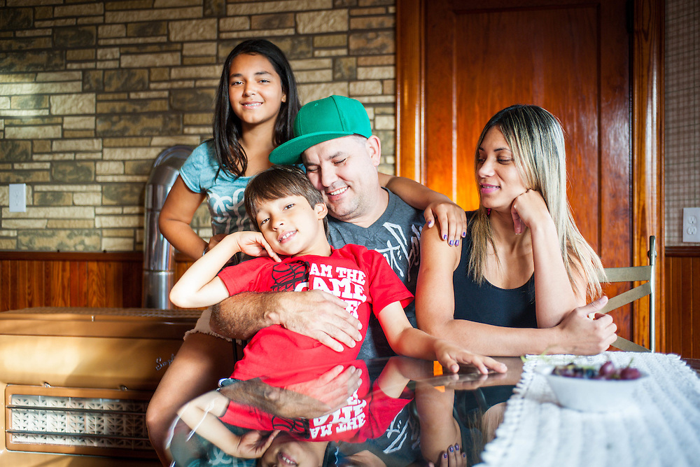 A Fall River family in their home for the Mass Housing Annual Report.