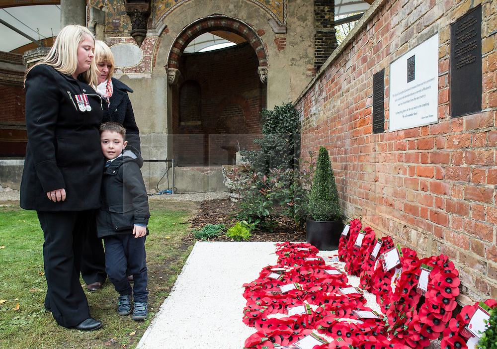 © London News Pictures. Mother, wife and son Jack of Fusilier Lee Rigby, The Royal Regiment of Fusiliers, Died 22nd May 2013, aged 25. A new memorial in St George's Chapel to those from the Borough who lost their lives in Service since the end of WW2.  Fusilier Rigby is one of eleven men named on the memorial in the ruins of the Royal Artillery Garrison Church. Photo credit: Rupert Frere/LNP