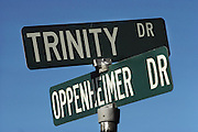 Street signs of two of the most famous names in the history of Nuclear bombs; Los Alamos, New Mexico. (Site) Trinity Drive and Oppenheimer Drive. (1985)
