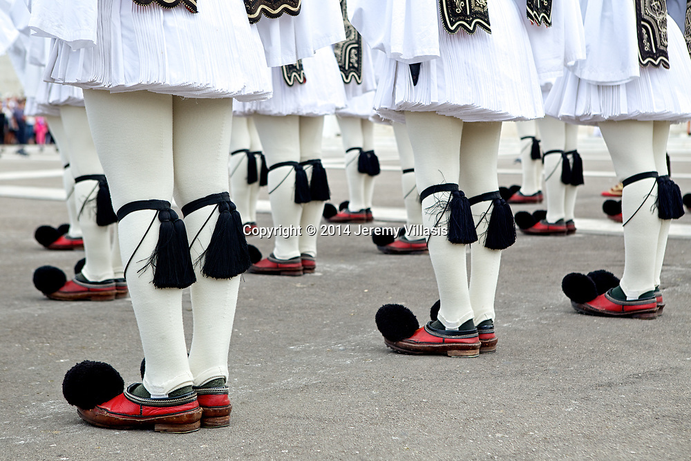 Detail of traditional Greek Evzones uniforms during the Changing of the Guard ceremony at the Tomb of the Unknown Soldier near syntagma Square in Athens, Greece.<br /> <br /> The traditional shoes of Evzones called  tsarouchia are red and is made of leather, with a small tuft in front. Each shoe weighs three kilos