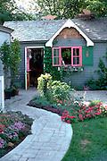 Decorative curved sidewalk lined with flowers to store.  Minnetonka Minnesota USA