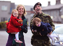 Comdt Murtagh Brennan, from Tipperary, with his wife Theresa and daughters Caoimhe,1, (left) and Saoirse, 2, at Custume Barracks, Athlone, following a review of the 110th Infantry Battalion ahead of their six-month deployment to South Lebanon as part of United Nations Interim Force in Lebanon (Unifil).