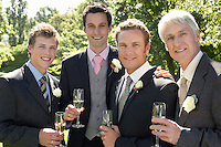 Four men toasting at wedding portrait