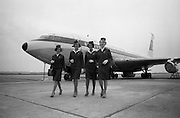 A new uniform for Aer Lingus Hostesses was introduced at Dublin Airport. .The new uniform, designed by Irene Gilbert, consists of a two-piece suit in ivy-green lightweight tweed, a matching top-coat in a heavier tweed, a shower-proof coat with a matching head-piece and a forage style hat. The skirt is approximately 1 to 1 1/2 inches above the knee.  Picture shows Aer Lingus Hostesses Imelda Grant, Eileen Malone, Eilish O'Connor and Goderic Abele wearing the new uniform..15.06.1966