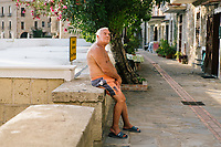 ACCIAROLI, ITALY - 14 SEPTEMBER 2018: Enzo Speranza (78) poses for a portrait in Acciaroli, a small fishing village in the municipality of Pollica, Italy, on September 14th 2018. Mr Speranza, who lives in Vallo della Lucania (about 30 kilometers from Acciaroli) spends 3 months a year in Acciaroli because of its fresh air and healthy lifestyle. He comes to the beach to exercise and relax every day.<br /> <br /> To understand how people can live longer throughout the world, researchers at University of California, San Diego School of Medicine have teamed up with colleagues at University of Rome La Sapienza to study a group of 300 citizens, all over 100 years old, living in Acciaroli (Pollica), a remote Italian village nestled between the ocean and mountains in Cilento, southern Italy.<br /> <br /> About 1-in-60 of the area's inhabitants are older than 90, according to the researchers. Such a concentration rivals that of other so-called blue zones, like Sardinia and Okinawa, which have unusually large percentages of very old people. In the 2010 census, about 1-in-163 Americans were 90 or older.