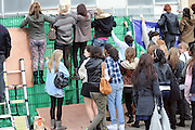 29.OCTOBER.2010. LONDON<br /> <br /> X FACTOR MANIA IS IN FULL FLOW AS EXCITED FANS TEAR APART THE FENCING OUTSIDE  FOUNTAIN STUDIOS IN WEMBLEY.<br /> <br /> BYLINE: EDBIMAGEARCHIVE.COM<br /> <br /> *THIS IMAGE IS STRICTLY FOR UK NEWSPAPERS AND MAGAZINES ONLY*<br /> *FOR WORLD WIDE SALES AND WEB USE PLEASE CONTACT EDBIMAGEARCHIVE - 0208 954 5968*