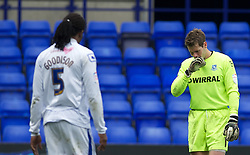 BIRKENHEAD, ENGLAND - Saturday, April 21, 2012: Tranmere Rovers' goalkeeper Owain Fon Williams walks off dejected after being sent off, past team-mate Ian Goodison who was originally shown the red card until the referee changed his him during the Football League One match against Hartlepool United at Prenton Park. (Pic by David Rawcliffe/Propaganda)