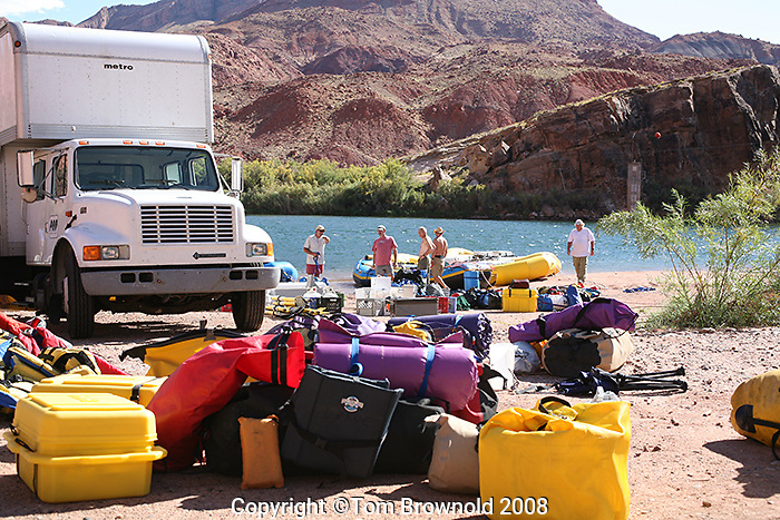 A shuttle company truck unloading gear at the Lee's Ferry for a private party on readying to put on Grand Canyon river trip.