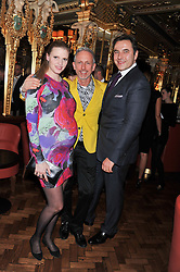 Left to right, LARA STONE, PATRICK COX and DAVID WALLIAMS at the 50th birthday party for Patrick Cox held at the Café Royal Hotel, 68 Regent Street, London on 15th March 2013.