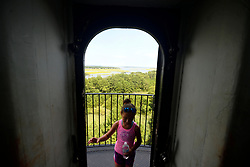 People take in the view panoramic view from atop of the 142-ft tall Assateague Lighthouse at Chincoteague Island, Accomack County, Virginia, during Labor Day weekend on September 1, 2018. The American public holiday of Labor Day, on the first Monday in September is considered the unofficial  end of Summer.