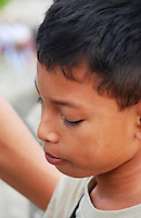 Close-up of a pouting Balinese boy.
