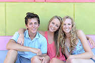 Colourful portrait of three attractive young friends hanging out together in summer.