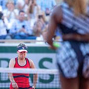 PARIS, FRANCE June 01. Winner Sofia Kenin of the United States heads to meet Serena Williams of the United States at the net after her victory during the Women's Singles third round match on Court Philippe-Chatrier at the 2019 French Open Tennis Tournament at Roland Garros on June 1st 2019 in Paris, France. (Photo by Tim Clayton/Corbis via Getty Images)