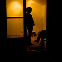 Silhouettes of people standing in a doorway