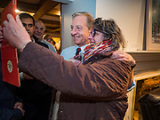 13 JANUARY 2020 - WEST DES MOINES, IOWA: TOM STEYER poses for a selfie with a woman at a house party in West Des Moines Monday night. The main issue was climate change, which Steyer has said is his top priority. Steyer, a California businessman, is campaigning to be the Democratic nominee for the US Presidency in 2020. Iowa holds the first selection event of the 2020 election cycle. The Iowa Caucuses are Feb. 3, 2020.               PHOTO BY JACK KURTZ