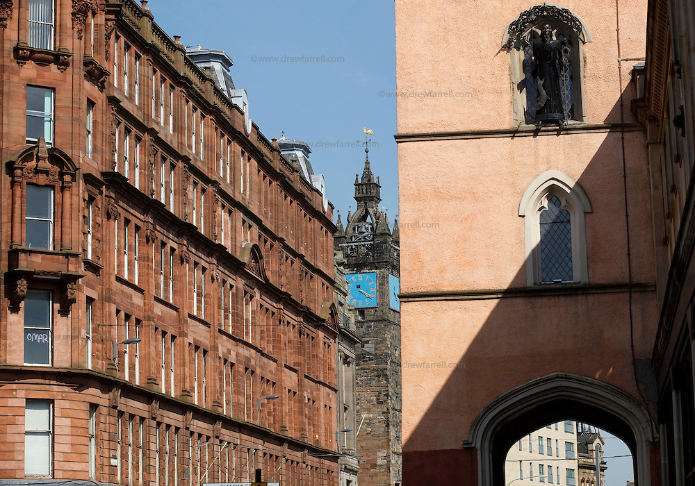 Picture shows : The Tron (right) and Glasgow Cross Clock (centre). Merchant City Area, Glasgow. Travel guide feature..Picture Drew Farrell. tel : 07721-735041......
