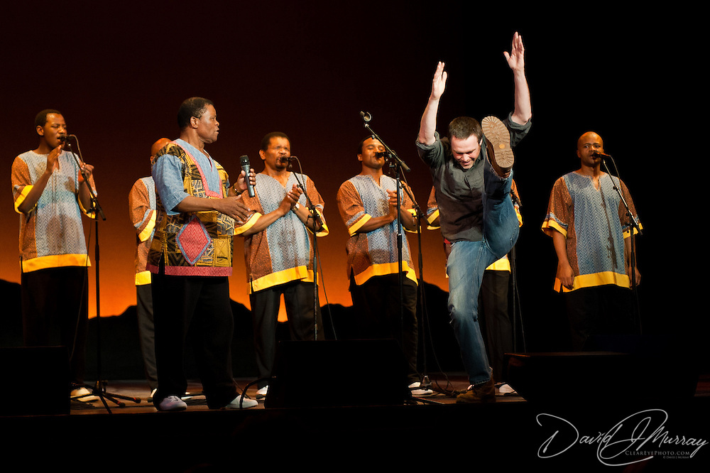 An audience member joins the high kicking/dancing with Ladysmith Black Mambazo at The Music Hall, Portsmouth, NH