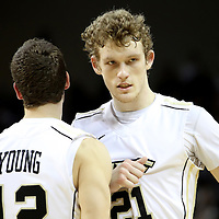 Central Florida forward P.J. Gaynor (21) speaks with teammate Central Florida guard Taylor Young (12)  during a Conference USA NCAA basketball game between the Memphis Tigers and the Central Florida Knights at the UCF Arena on February 9, 2011 in Orlando, Florida. Memphis won the game 63-62. (AP Photo: Alex Menendez)