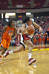 28 March 2010: Ashleen Bracey breaks past the 3 point line as she also passes Karisma Penn. The Redbirds of Illinois State squeak past the Illini of Illinois 53-51 in the 4th round of the 2010 Women's National Invitational Tournament (WNIT) on Doug Collins Court inside Redbird Arena at Normal Illinois.