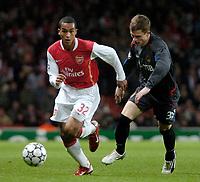 Photo: Ed Godden.<br /> Arsenal v CSKA Moscow. UEFA Champions League, Group G. 01/11/2006. Arsenal's Theo Walcott (L) takes the ball past Ivan Taranov.