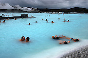 Volcanically heated geothermal spring pools create a surreal natural spa experience at the Blue Lagoon.