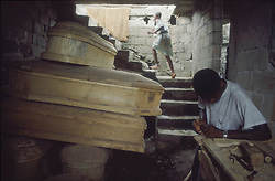 CAP HAITIEN, HAITI - Coffin-making is one of the few thriving businesses in Cap Haitien.(PHOTO © JOCK FISTICK)