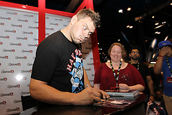 October 7, 2011; Houston, TX.; USA;  Matt Mitrione signs autographs at the Hayabusa booth at UFC 136 Fan Expo at the George R. Brown Convention Center in Houston, TX.