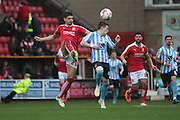 Swindon Town defender Raphael Rossi-Branco and Coventry City midfielder Ryan Kent during the Sky Bet League 1 match between Swindon Town and Coventry City at the County Ground, Swindon, England on 24 October 2015. Photo by Jemma Phillips.