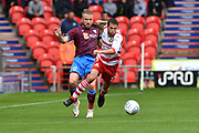 Doncaster Rovers midfielder Matty Blair (17) and Scunthorpe United forward Paddy Madden (9)  during the EFL Sky Bet League 1 match between Doncaster Rovers and Scunthorpe United at the Keepmoat Stadium, Doncaster, England on 17 September 2017. Photo by Ian Lyall.
