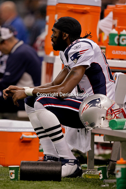 2009 November 30:  New England Patriots wide receiver Randy Moss (81)sits on the bench during the first half against the New Orleans Saints at the Louisiana Superdome in New Orleans, Louisiana.