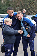 AFC Wimbledon defender Rod McDonald (4) and AFC Wimbledon attacker Shane McLoughlin (19) with a fan posing to take a photo during the EFL Sky Bet League 1 match between AFC Wimbledon and Southend United at the Cherry Red Records Stadium, Kingston, England on 1 January 2020.