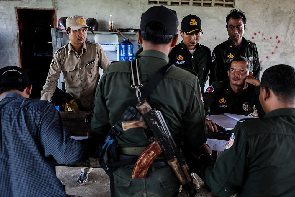 Cambodia, 2012. Morning briefing at Steung Prau Station.