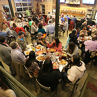 Area residents pack Mugshots Grill & Bar in Tupelo Tuesday night for Celebrity Wait Night to benefit The Make a Wish Foundation.