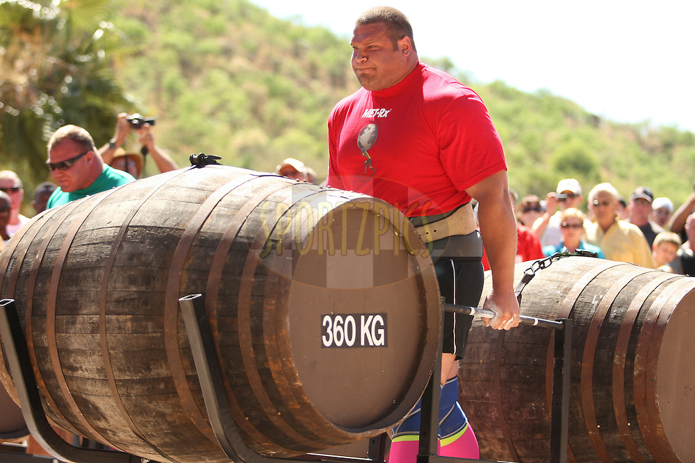 Terry Hollands (UK) sets off at a strong and steady pace in the whiskey-barrel walk during the final rounds of the World's Strongest Man competition held in Sun City, South Africa.