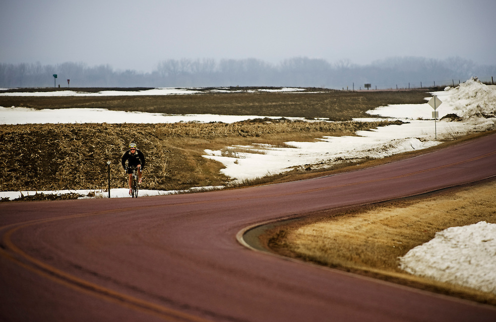Dan Letche biking in rain and fog South of Vermillion, SD on March 10, 2010..