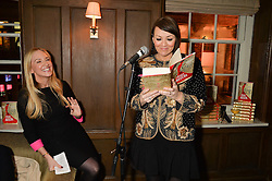 Left to right, ROSIE NIXON watches MARTINE McCUTCHEON reading from The Stylist at a party to celebrate the publication of The Stylist by Rosie Nixon held at Soho House, London on 10th February 2016.