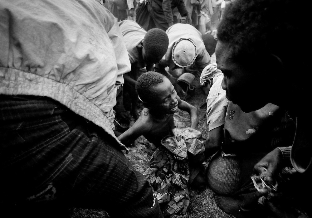 Refugees fighting for food in the camps outside Goma, Zaire. 1994 -<br /> The sun had set over the rwandan capital Kigali as president Juvenal Habyarimana's plane approached the city's airport on 6.april 1994.Suddenly, out of the darkness, a rocket hit the plane and sent it crashing to the ground, killing everyone on board.over the next three month's, more than 800.000 rwandans would be murdered, many cut down with machetes, killed by neighbours and countrymen, in a ferocious ethnic genocide that was all but ignored by the international world.