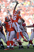 Cleveland Browns outside linebacker Armonty Bryant (95) stretches out his hand as he jumps high in the air trying to block a field goal attempt next to Cleveland Browns nose tackle Danny Shelton (71) during the 2015 week 8 regular season NFL football game against the Arizona Cardinals on Sunday, Nov. 1, 2015 in Cleveland. The Cardinals won the game 34-20. (©Paul Anthony Spinelli)