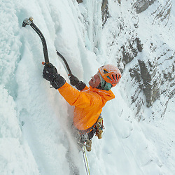 Brent Peters ice climbing Murchison Falls, Banff National Park, Alberta, BC. This is a steeper WI5 pitch this is not the normal route, it was -25c this day and windy, you can tell looking at the snow in his stache that it was chilly.