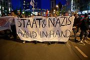 Frankfurt am Main | 21 Apr 2015<br /> <br /> Am Dienstag (21.04.2015) hielt die rassistische und islamfeindliche Gruppe PEGIDA (Patriotische Europ&auml;er gegen die Islamisierung des Abendlandes) an der Hauotwache neben der Katharinenkirche in Frankfurt am Main eine Mahnwache unter dem Motto &quot;Wir sind wieder da&quot; ab. Die Kundgebung war wie immer mit Hamburger Gittern abgesperrt und von starken Polizeikr&auml;ften bewacht. Etwa 1000 Menschen nahmen an den Gegenprotesten teil.<br /> Hier: Gegendemonstranten mit einem Transparent mit der Aufschrift &quot;Staat und Nazis Hand in Hand&quot; bei einer Spontandemo nach Ende der Pegida-Kundgebung auf dem Weg zum Hauptbahnhof, bei dieser Demo ging es um Flucht und Fl&uuml;chtlinge.<br /> <br /> &copy;peter-juelich.com<br /> <br /> [Foto Honorarpflichtig | No Model Release | No Property Release]