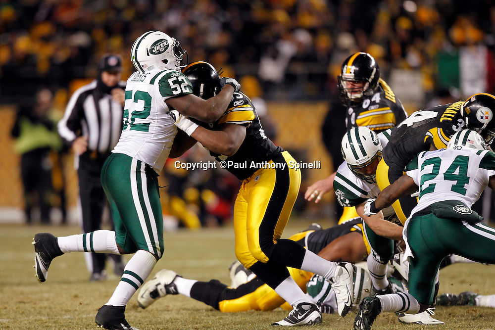 Pittsburgh Steelers tight end David Johnson (85) blocks New York Jets linebacker David Harris (52) during the NFL 2011 AFC Championship playoff football game against the New York Jets on Sunday, January 23, 2011 in Pittsburgh, Pennsylvania. The Steelers won the game 24-19. (©Paul Anthony Spinelli)