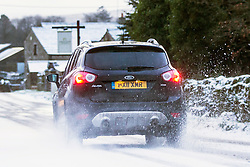 © Licensed to London News Pictures. 14/12/2017. Simonstone UK. Drivers faced difficult driving conditions this morning on the roads around Simonstone in the Yorkshire Dales after a night of snowfall. Photo credit: Andrew McCaren/LNP