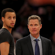 Steph Curry, Golden State Warriors, talking with Warriors Head Coach Steve Kerr during a match against the New York Knicks. NBA Basketball. Madison Square Garden, New York. USA.  Photo Tim Clayton
