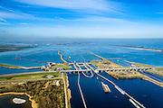 Nederland, Zeeland, Gemeente Schouwen-Duiveland, 01-04-2016; Philipsdam en Krammersluizen. Rechts in de achtergrond de Grevelingendam. <br /> Dam en sluiscomplex vormen een compartimenteringswerk waardoor het zoete water van Volkerak en het zoute water van het Krammer gescheiden blijft. Het Krammer, aan gene zijde van de sluizen staat in verbinding met de Oosterschelde. Het geheel maakt deel uit maken van de Deltawerken.<br /> Philipsdam with Krammersluizen, part of the Delta Works. The locks form a division between sweet and salt water.<br /> <br /> luchtfoto (toeslag op standard tarieven);<br /> aerial photo (additional fee required);<br /> copyright foto/photo Siebe Swart