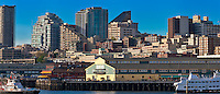 A long panorama of a slice of the Seattle waterfront buildings and those on the hill behind.  The view from these windows is Puget Sound with the Olympic Mountains across the water.