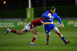 Federico Mori of Italy is tackled by Aneurin Owen of Wales <br /> <br /> Photographer Craig Thomas/Replay Images<br /> <br /> U20 Six Nations - Wales v Italy  - Friday 31st January 2020 - Stadiwm Zip World (Parc Eirias) - Colwyn Bay<br /> <br /> World Copyright © Replay Images . All rights reserved. info@replayimages.co.uk - http://replayimages.co.uk