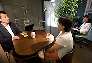 """Keiko"" (l) undertakes a class simulating a first date with her unidentified coach as at Infini, a school training marriage hopefuls how to hook Mr. or Mrs. Right in Tokyo, Japan on Sep. 9, 2010. At right, school head Etsuko Satake listens on and takes notes for a subsequent critique of the session."